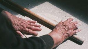 Hands making a pie in Greece