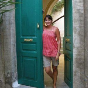 woman beside a green door