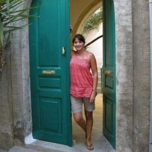 girl beside a green door
